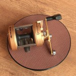 "Vantage 880 gold multiplier reel showing size, turntable is 8"" diameter"