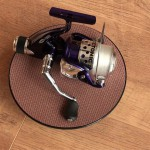 """Tectonic 7600 fixed spool reel showing size on an 8"""" turntable"""