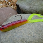 Twin tail turbo sunset cod lure showing super sharp hook