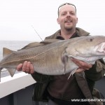 Dave with a 12lb Cod taken on a savage lure